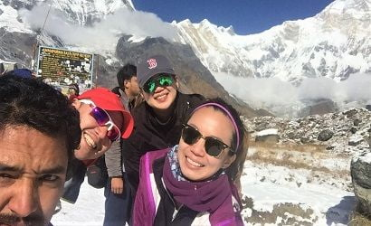guide taking selfie with his group at annapurna basecamp