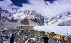 view of everest basecamp seen in the spring - yellow tents are everest expedition tents