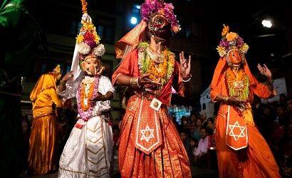 newar community performing their cultural dance during local festival in patan durbar square