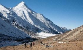 walking by kumbhakarna himal in kanchenjunga trek itinerary