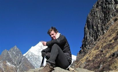 face of joe in the picture shows Langtang Valley Trek Difficulty, the picture is from the top of kyanjing ri, however.