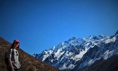 emily on her solo trek to langtang valley on her way down from kyanjing ri hike, mt Dorje lakpa on the sight