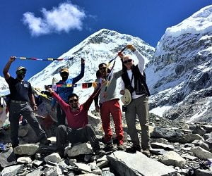 team with prayer flags at Everest base camp
