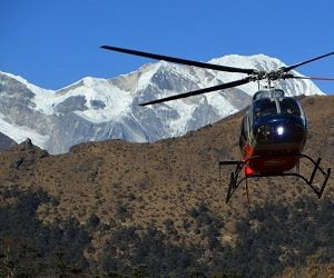 Flying out with helicopter from the other side of thorong la pass in annapurna circuit trekking