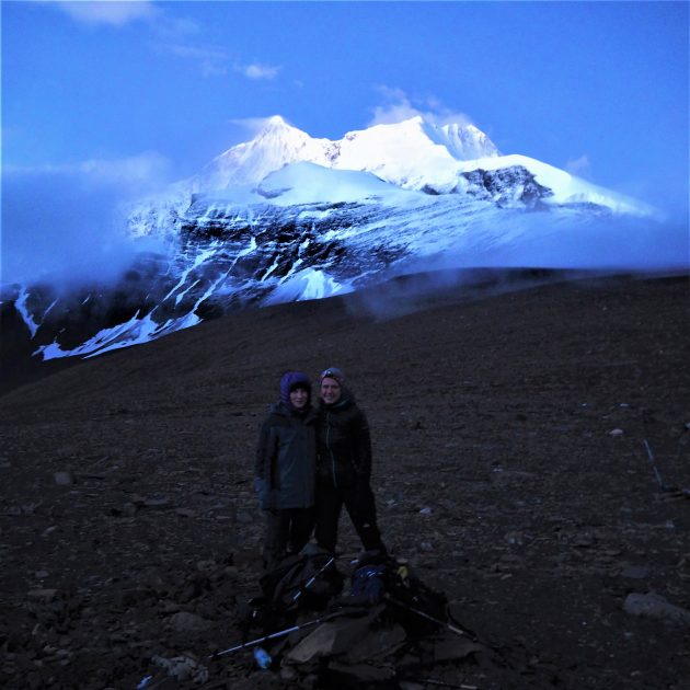 Happy trekkers infront of Dhaulagiri in their adventure trek to Dhaulagiri base camp