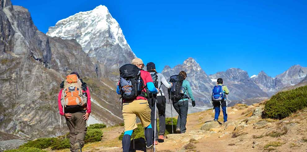 Trekkers on their move towards Everest basecamp in Dusa valley trail of EBC Arun Valley trekking tour in Nepal
