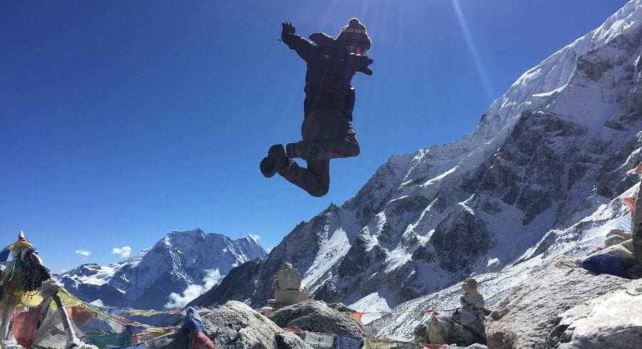 His high jump at the top of larkey pass with all his energy in easy manaslu circuit trek