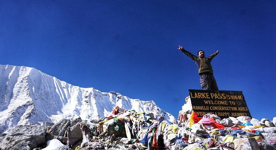 At the top of Manaslu larkey pass by the side of the hording board of Larkey pass 5106m
