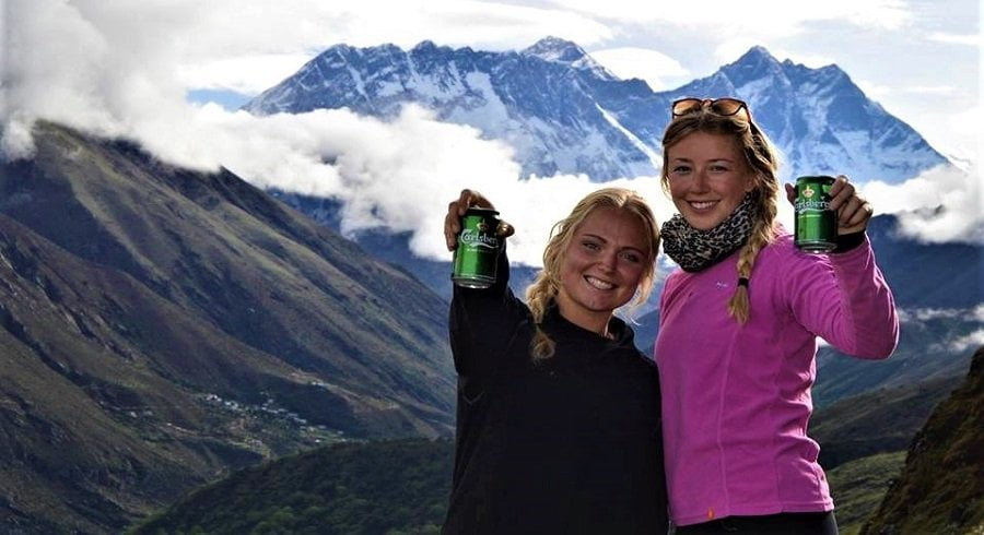 Denis girls with carlsberg beer infront of Mount Everest.
