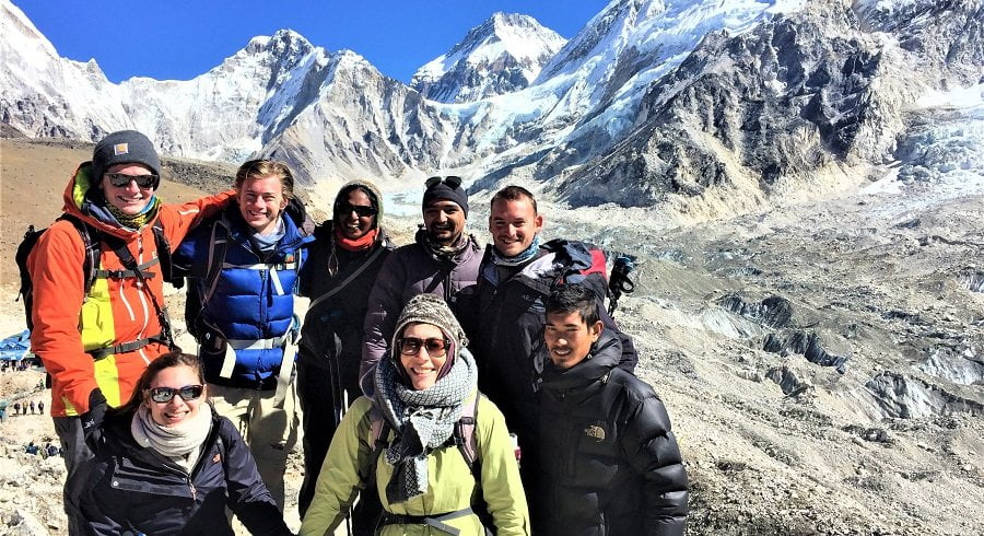Everest 3 high pass trekking team posing right infront of Gorakshep village