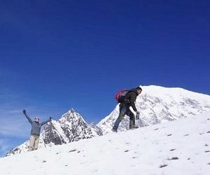 Trekker excited on the top of kyanjing ri on langtang valley circuit hike