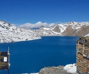 Tilicho lake seen in the spring season, trekkers trek towards thorong la pass after visiting the lake