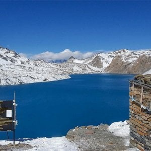 Tilicho lake seen in the spring season, trekkers trek towards thorong la pass after visiting the lake in our Annapurna circuit with tilicho lake trek