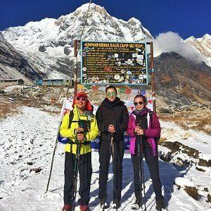 Annapurna Basecamp hording board and 3 trekkers posing