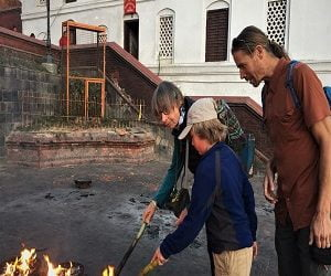 Clients involving in local fest while touring spiritual Nepal day tour