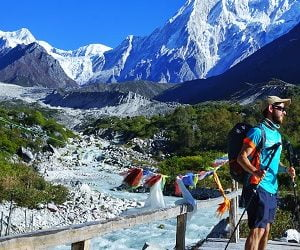 guy on the wooden bridge on his rapid manaslu trek