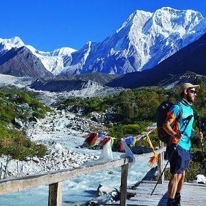 guy on the wooden bridge on his rapid manaslu trek