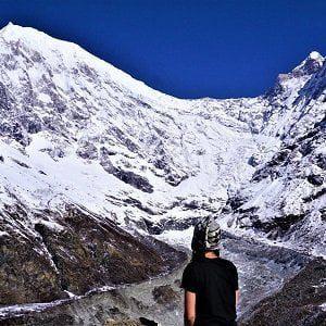 girl looking at langtang glacier on her langtang valley trek