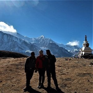 trekkers on side trip to 1000 lamas monastery on the hill top in acclimatization day of round Annapurna trek