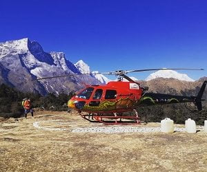 Helicopter landing infront of Everest range in Everest Nepal Luxury Tour program
