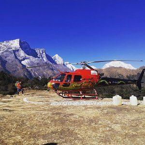 Helicopter landing infront of Everest range in Everest Nepal Luxury Tour program