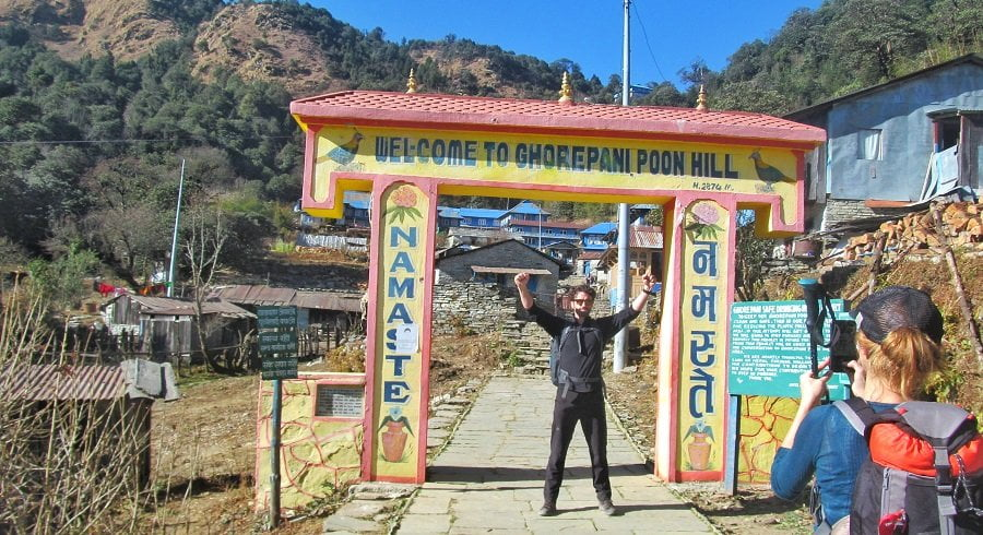 stewart excited at the gate of poonhill in his trekking tour in nepal
