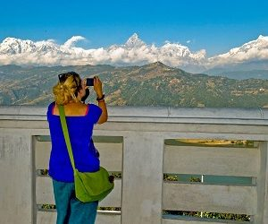 girl capturing the moment at pokhara in her Kathmandu & Pokhara Tour