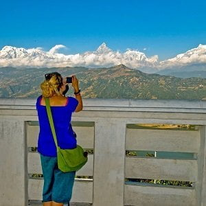 girl capturing the moment at pokhara in her Kathmandu Pokhara Tour