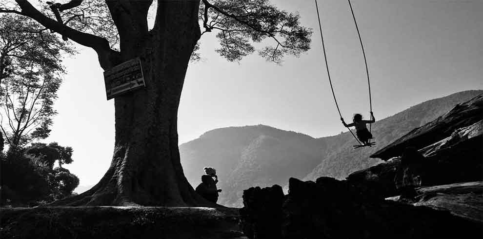 Swinging on the occasion of Tihar festival - captured on october tour of Bungmati Khokana day tour