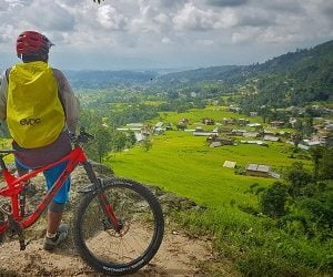 Praveen staring at local village on Chitlang cycling tour