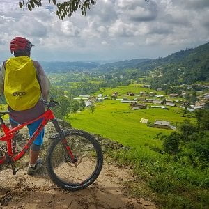 Praveen staring at local village on Chitlang cycling tour