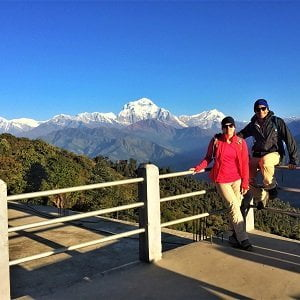 Trekking couple at Ghorepani village posing infront of Mt Dhaulagiri range, we leave to Ghandruk village after this picture.