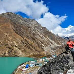 Happy guy infront of gokyo ri, gokyo lake anf the village in his trek to gokyo valley