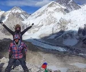 Couple taking their picture on Honeymoon trek, helicopter landed infront of Everest base camp