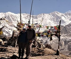 couple at the kanchenjunga base camp in their circuit trek in remote Nepal