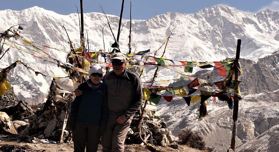 Old couple with young smile at the Kanchenjunga base camp