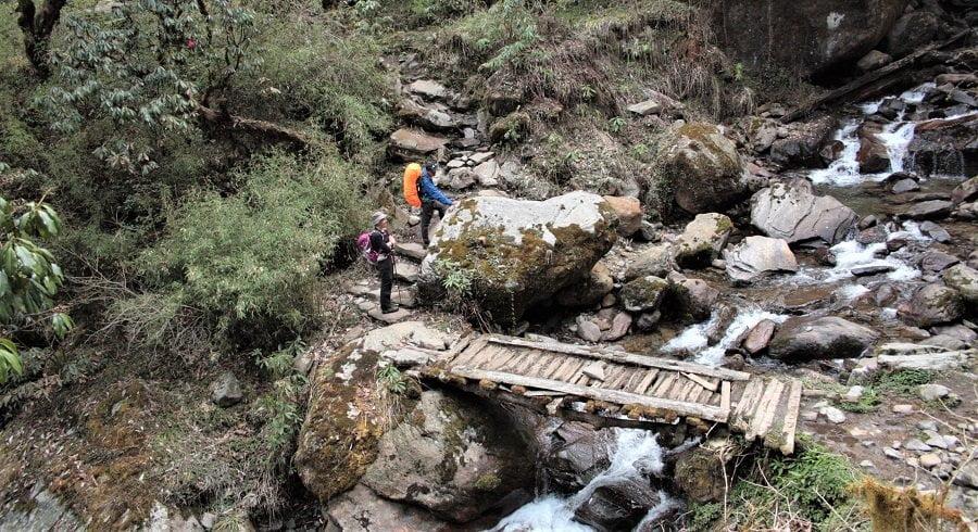 Wooden bridge before starting trekking through the jungle of Khopra ridge trek in nepal