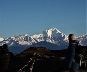 A man looking at Dhaulagir from Khopra danda before his return trek