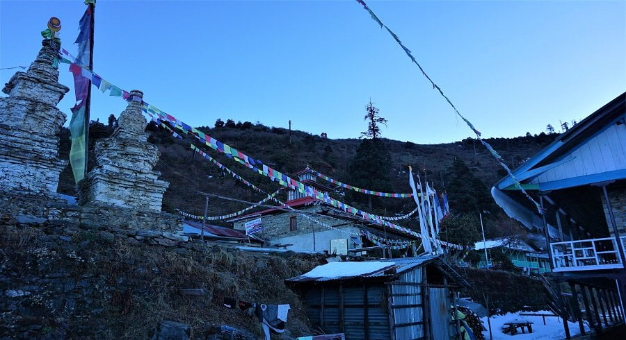 Centuries old chhorten and buddhist prayer flags