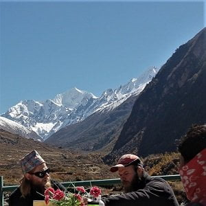 Boys enjoying the view and having their breakfast at Langtang valley section of langtang circuit trek