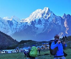 old man taking picture of moutanins in the bhimtang valley of Manaslu Tsum Valley Trekking