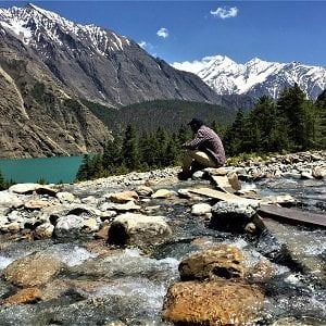 Our guest staring at the phoksudo lake on his Phoksundo lake Dolpo Trekking