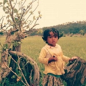 girl in the farm seen on Rampur Village Charity Tour