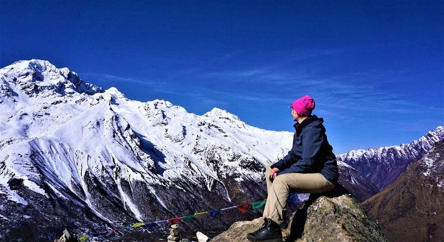 Taru looking at the Nayakang peak on her Tamang heritage trekking