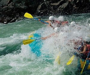 Folks enjoying the river water splashing during Rafting Trip in Nepal