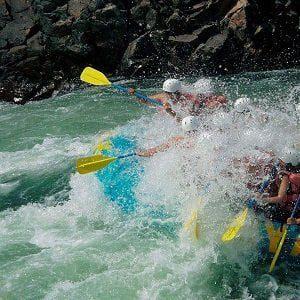 Folks enjoying the river water splashing during Rafting Trip in Nepal