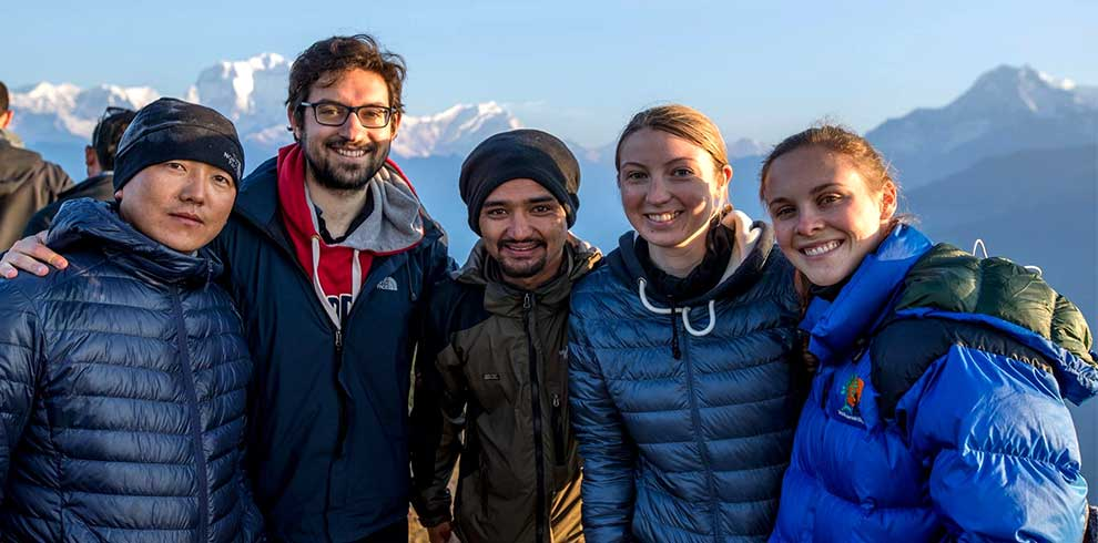 Taking a group picture at poonhill, poonhill is a gateway to short Annapurna base camp trek
