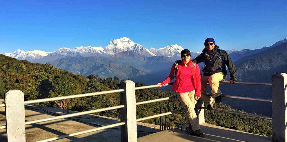 A couple pose at Ghorepani village on their way to short Annapurna basecamp trek