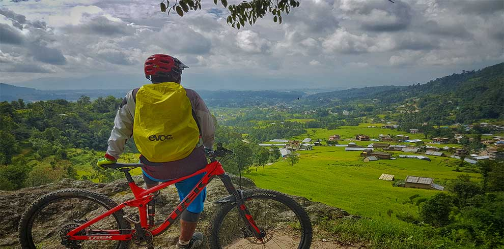 towards the finish line of chitalng cycling tour - staring at the village for a short break