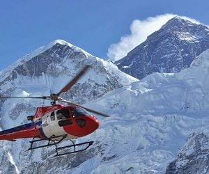 Helicopter flying right next to Mount everest in Everest basecamp helicopter landing tour